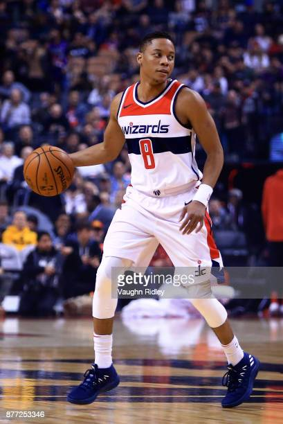 Tim Frazier of the Washington Wizards dribbles the ball during the first half of an NBA game against the Toronto Raptors at Air Canada Centre on...