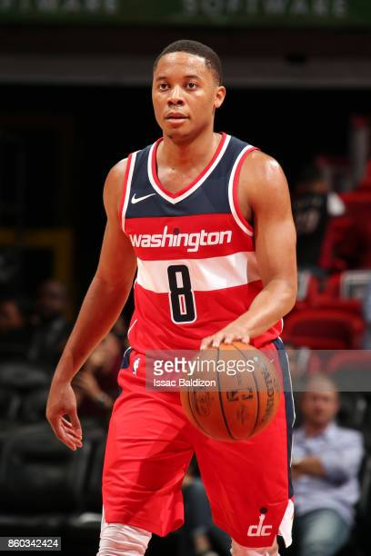 Tim Frazier of the Washington Wizards handles the ball during a preseason game against the Miami Heat at the American Airlines Arena on October 11...