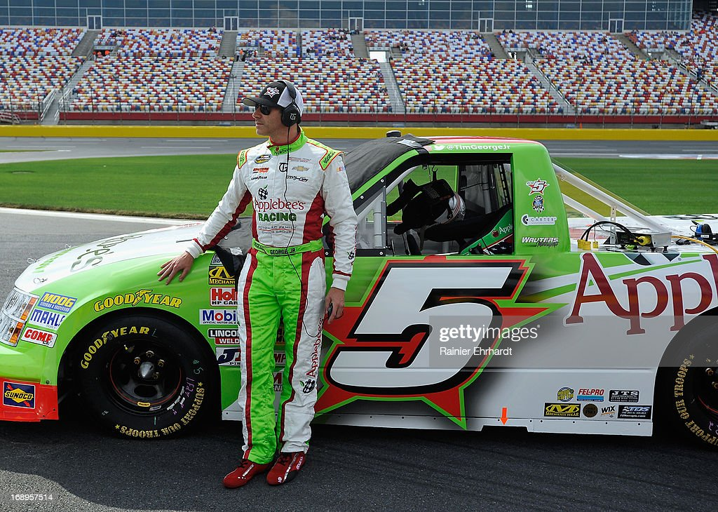 Tim George Jr. , driver of the #5 Applebee's Chevrolet, stand by his truck during qualifying for the NASCAR Camping World Truck Series North Carolina Education Lottery 200 at Charlotte Motor Speedway on May 17, 2013 in Concord, North Carolina.