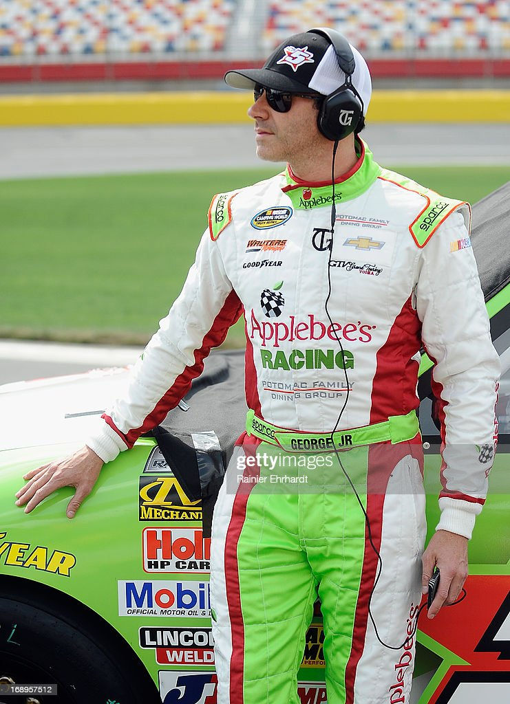 Tim George Jr. , driver of the #5 Applebee's Chevrolet, stands on pit road during qualifying for the NASCAR Camping World Truck Series North Carolina Education Lottery 200 at Charlotte Motor Speedway on May 17, 2013 in Concord, North Carolina.