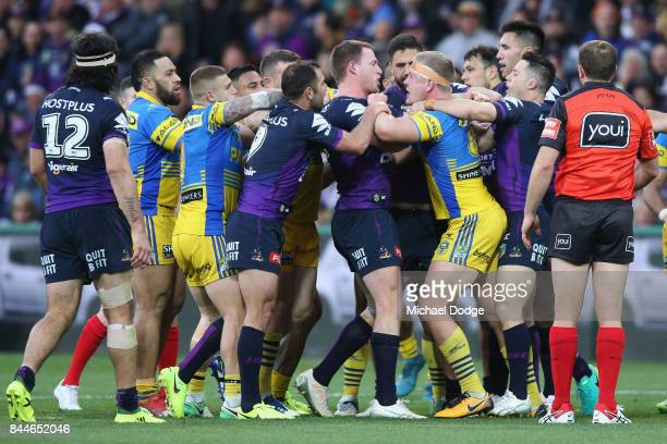 Tim Glasby of the Storm and Daniel Alvaro of the Eels wrestle during the NRL Qualifying Final match between the Melbourne Storm and the Parramatta...