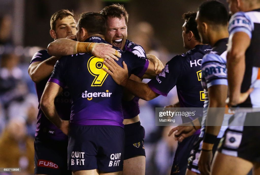 Tim Glasby of the Storm celebrates with team mates after scoring a try during the round 14 NRL match between the Cronulla Sharks and the Melbourne Storm at Southern Cross Group Stadium on June 8, 2017 in Sydney, Australia.