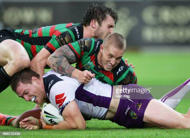 Tim Glasby of the Storm is tackled during the round 11 NRL match between the South Sydney Rabbitohs and the Melbourne Storm at nib Stadium on May 21...