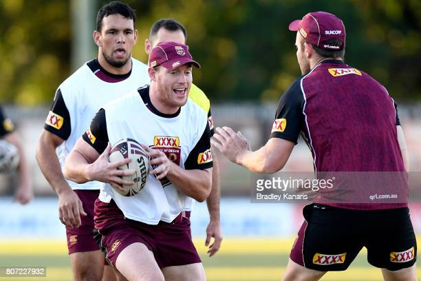 Tim Glasby takes on the defence during a Queensland Maroons State of Origin training session at Langlands Park on July 4 2017 in Brisbane Australia