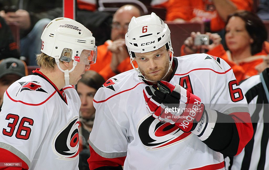 Tim Gleason #6 and Jussi Jokinen #36 of the Carolina Hurricanes talk during a stoppage in play against the Philadelphia Flyers on February 2, 2013 at the Wells Fargo Center in Philadelphia, Pennsylvania.