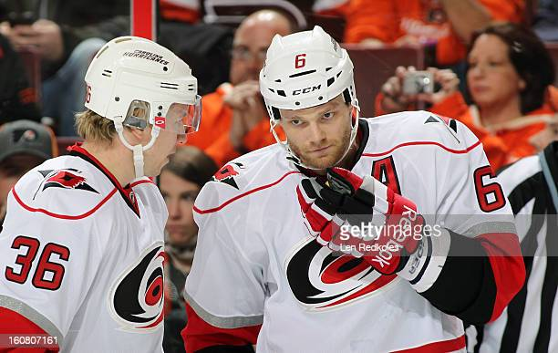Tim Gleason and Jussi Jokinen of the Carolina Hurricanes talk during a stoppage in play against the Philadelphia Flyers on February 2 2013 at the...