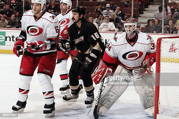 Tim Gleason and Manny Legace of the Carolina Hurricanes defend the net against George Parros of the Anaheim Ducks during the game on November 25 2009...