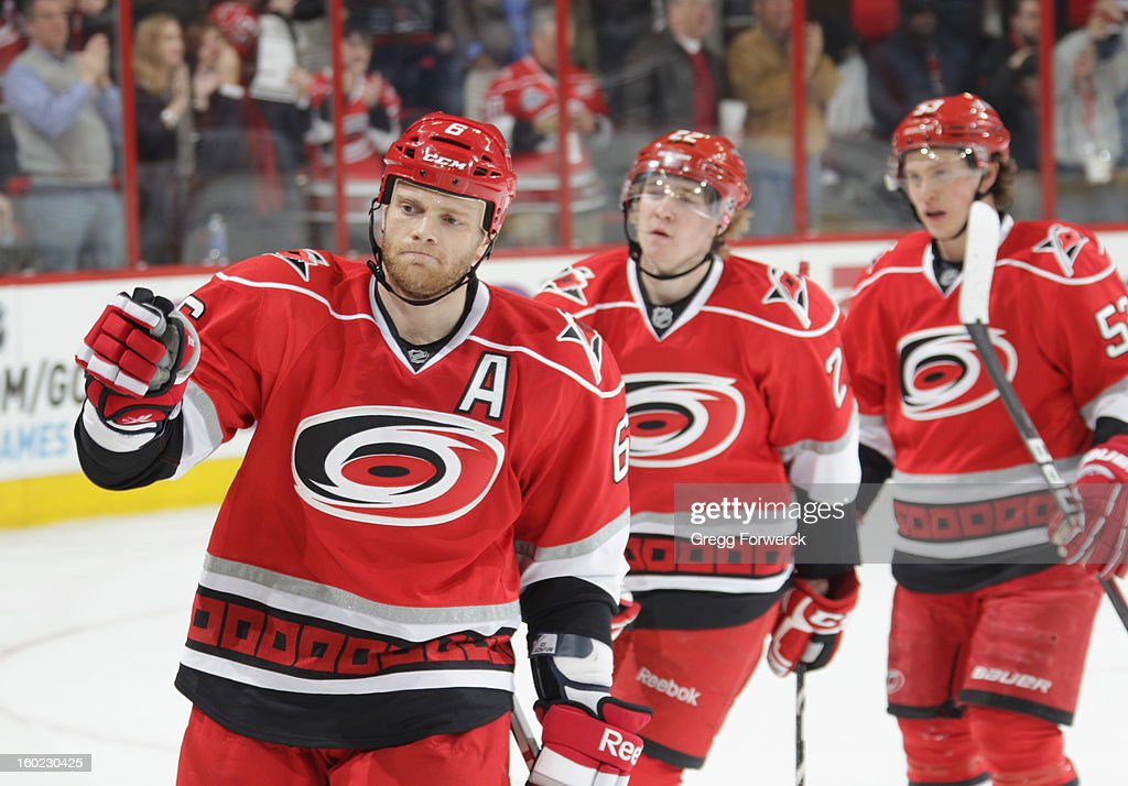 Tim Gleason #6 and teammates Zac Dalpe #22 and Jeff Skinner #53 of the Carolina Hurricanes are congratulated after a goal is scored against the Buffalo Sabres during their NHL game at PNC Arena on January 24, 2013 in Raleigh, North Carolina.