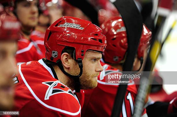 Tim Gleason of the Carolina Hurricanes against the Buffalo Sabres during play at PNC Arena on March 5 2013 in Raleigh North Carolina