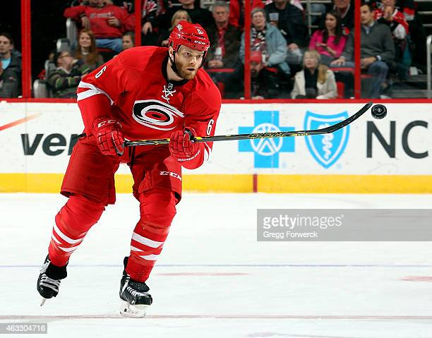 Tim Gleason of the Carolina Hurricanes bats down an errant puck during an NHL game against the Anaheim Ducks during at PNC Arena on Febuary 12 2015...