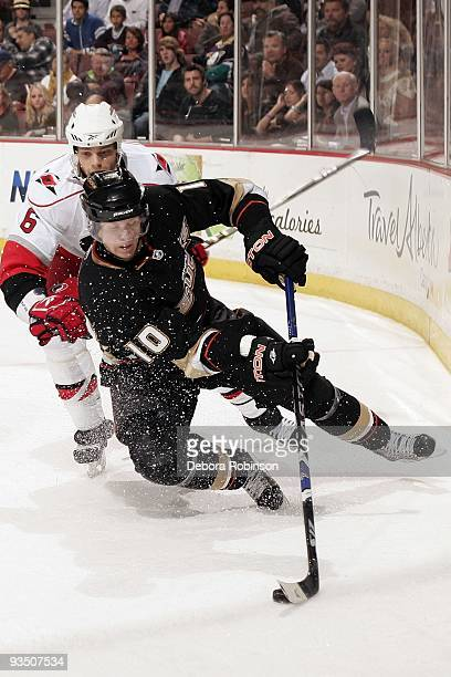 Tim Gleason of the Carolina Hurricanes battles for the puck against Corey Perry of the Anaheim Ducks during the game on November 25 2009 at Honda...