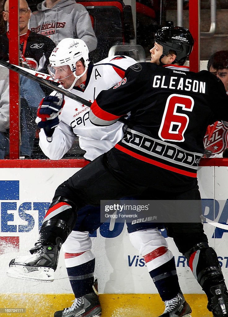 <a gi-track='captionPersonalityLinkClicked' href=/galleries/search?phrase=Tim+Gleason&family=editorial&specificpeople=211575 ng-click='$event.stopPropagation()'>Tim Gleason</a> #6 of the Carolina Hurricanes checks Troy Brower #20 of the Washington Capitals during their NHL game at PNC Arena on March 14, 2013 in Raleigh, North Carolina.