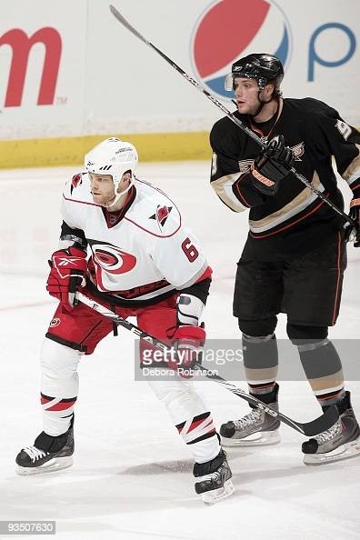 Tim Gleason of the Carolina Hurricanes defends against Bobby Ryan of the Anaheim Ducks during the game on November 25 2009 at Honda Center in Anaheim...
