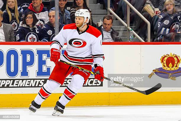 Tim Gleason of the Carolina Hurricanes keeps an eye on the play during first period action against the Winnipeg Jets on October 21 2014 at the MTS...