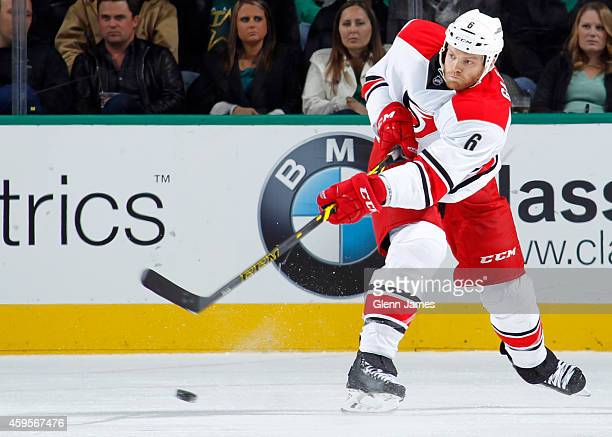 Tim Gleason of the Carolina Hurricanes makes a pass to a teammate against the Dallas Stars at the American Airlines Center on November 18 2014 in...