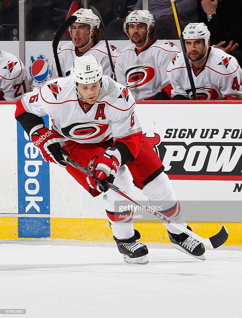Tim Gleason #6 of the Carolina Hurricanes plays the puck against the New Jersey Devils during the game at the Prudential Center on February 12, 2013 in Newark, New Jersey.