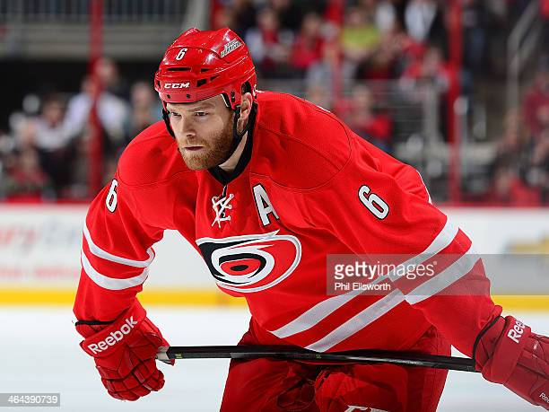 Tim Gleason of the Carolina Hurricanes prepares for a faceoff during an NHL game against the Pittsburgh Penguins on December 27 2013 at PNC Arena in...