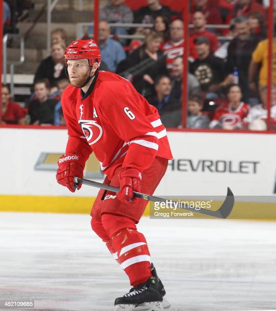 Tim Gleason of the Carolina Hurricanes skates for position on the ice during their NHL game against the Boston Bruins at PNC Arena on November 18...