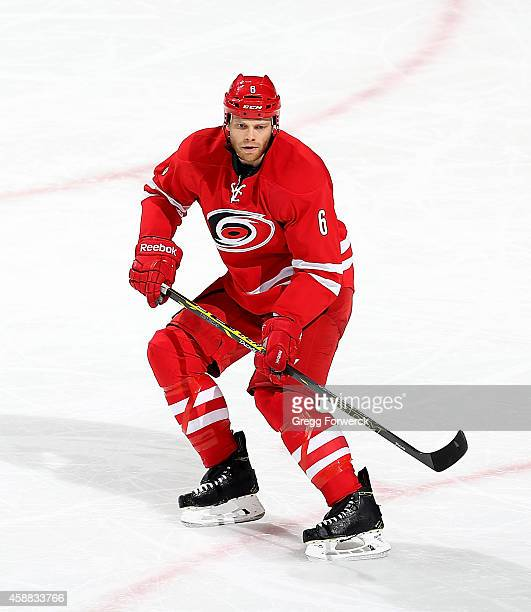 Tim Gleason of the Carolina Hurricanes skates for position on the ice during their NHL game against the Calgary Flames at PNC Arena on November 10...