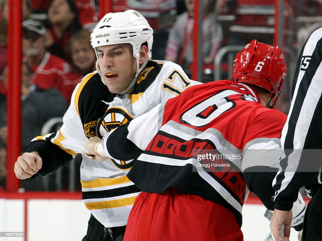 Tim Gleason #6 of the Carolina Hurricanes squares off with Milan Lucic #17 of the Boston Bruins during their NHL game at PNC Arena on January 28, 2013 in Raleigh, North Carolina.