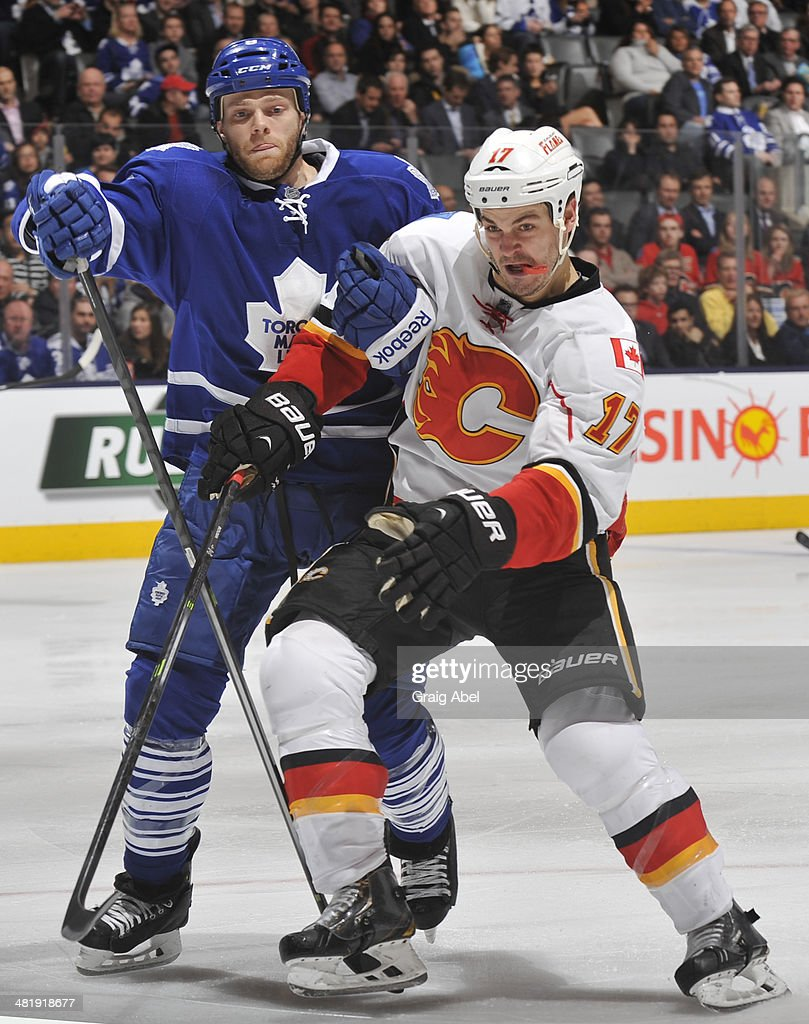 <a gi-track='captionPersonalityLinkClicked' href=/galleries/search?phrase=Tim+Gleason&family=editorial&specificpeople=211575 ng-click='$event.stopPropagation()'>Tim Gleason</a> #8 of the Toronto Maple Leafs battles with <a gi-track='captionPersonalityLinkClicked' href=/galleries/search?phrase=Lance+Bouma&family=editorial&specificpeople=4303790 ng-click='$event.stopPropagation()'>Lance Bouma</a> #17 of the Calgary Flames during NHL game action April 1, 2014 at the Air Canada Centre in Toronto, Ontario, Canada.