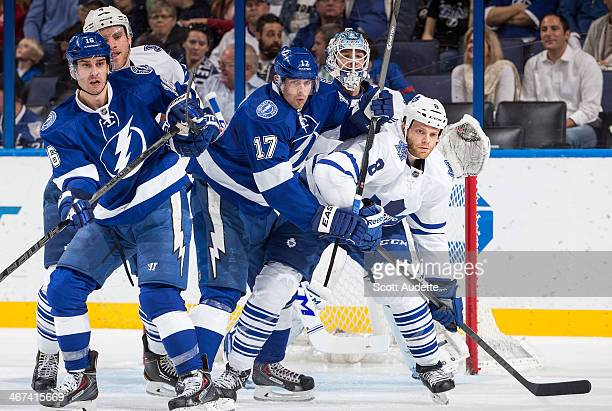 Tim Gleason of the Toronto Maple Leafs gets position in front of the net against Teddy Purcell and Alex Killorn of the Tampa Bay Lightning battle...