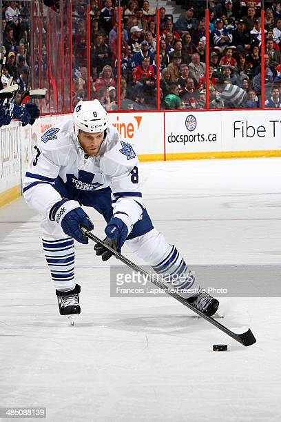 Tim Gleason of the Toronto Maple Leafs skates with the puck against the Ottawa Senators on April 12 2014 at Canadian Tire Centre in Ottawa Ontario...