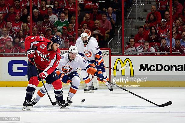 Tim Gleason of the Washington Capitals and Ryan Strome of the New York Islanders battle for the puck during the first period in Game Two of the...