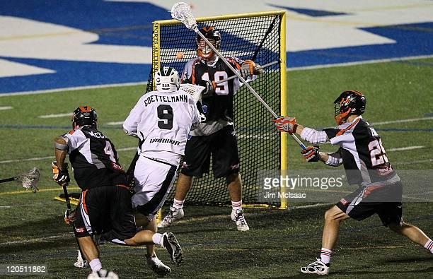 Tim Goettelmann of the Long Island Lizards scores a second half goal past Jesse Schwartzmann of the Denver Outlaws during their Major League Lacrosse...