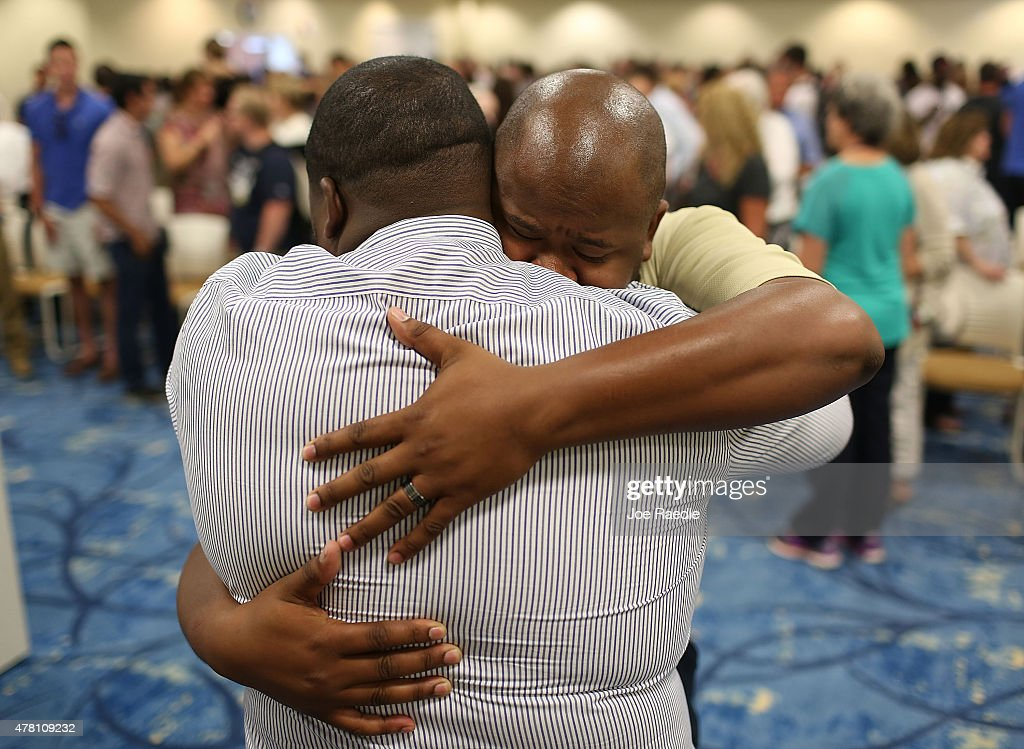 Tim Grant is comforted during a prayer vigil at the Charleston Southern University for the victims of the Emanuel African Methodist Episcopal Church mass shooting where nine people were killed, including two of Grant's cousins on June 22, 2015. Dylann Roof, 21 years old, is suspected of killing the nine people during a prayer meeting in the church, which is one of the nation's oldest black churches in Charleston.