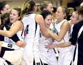 Alexa Brown left Jill Henrikson middle Katie Bergeron right and Ellery Gould far right celebrate after their win over Amherst College during the 2009...