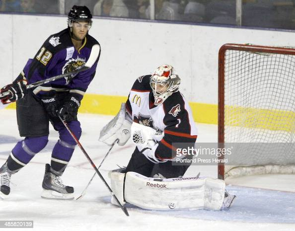 Portland Pirates goalie Justin Pogge makes a save during the hockey exhibition game featuring the Portland Pirates hosting the Manchester Monarchs at...