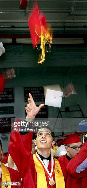 Sam Ouellette tosses his cap in the air at the conclusion of the South Portland High School graduation in the high school gym in South Portland on...