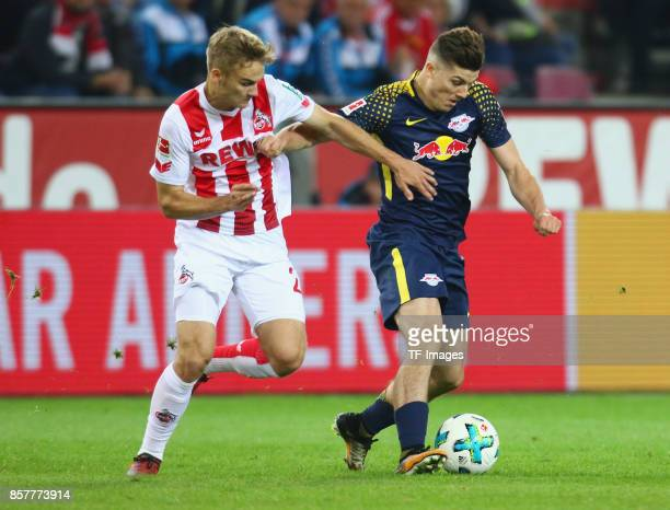 Tim Handwerker of Koeln and Marcel Sabitzer of Leipzig battle for the ball during the Bundesliga match between 1 FC Koeln and RB Leipzig at...