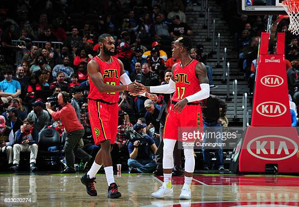 Tim Hardaway Jr #10 and Dennis Schroder of the Atlanta Hawks celebrate during a game against the New York Knicks on January 29 2017 at Philips Arena...