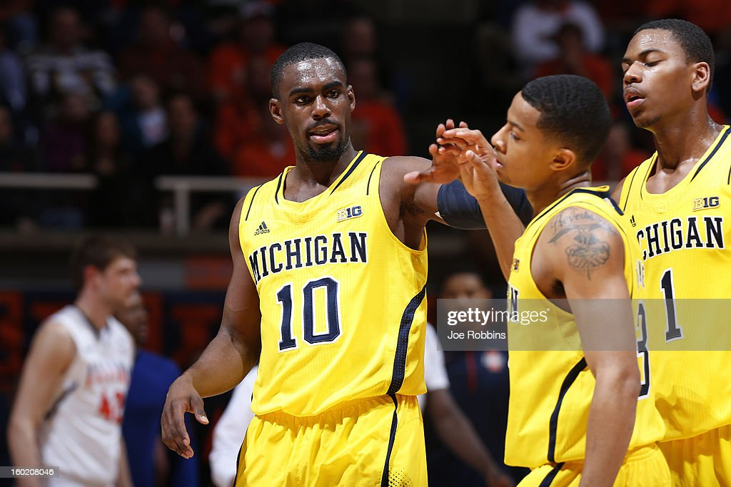 Tim Hardaway Jr. #10 and Trey Burke #3 of the Michigan Wolverines celebrate against the Illinois Fighting Illini during the game at Assembly Hall on January 27, 2013 in Champaign, Illinois. Michigan defeated Illinois 74-60.