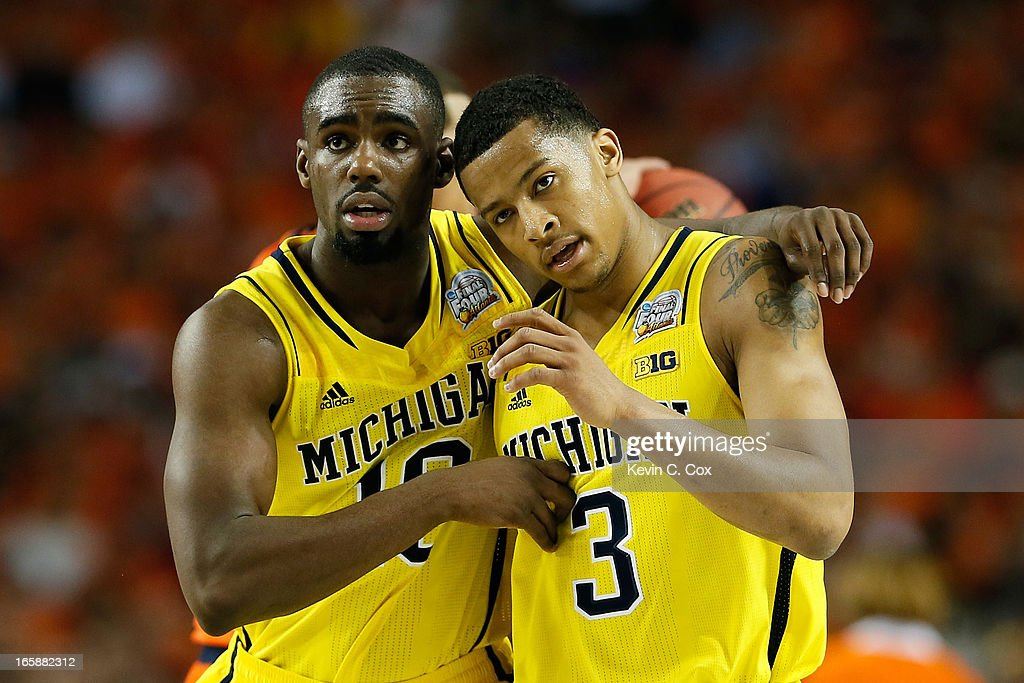 Tim Hardaway Jr. #10 and Trey Burke #3 of the Michigan Wolverines react in the second half against the Syracuse Orange during the 2013 NCAA Men's Final Four Semifinal at the Georgia Dome on April 6, 2013 in Atlanta, Georgia.