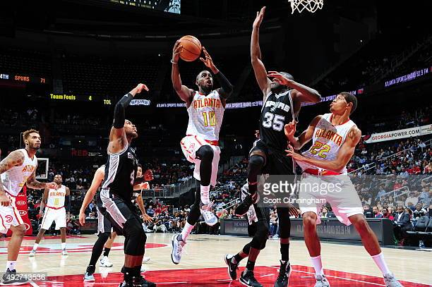 Tim Hardaway Jr #10 of the Atlanta Hawks goes to the basket against the San Antonio Spurs on October 14 2015 at Philips Arena in Atlanta Georgia NOTE...