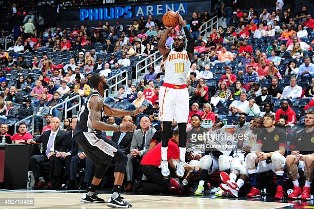 Tim Hardaway Jr #10 of the Atlanta Hawks shoots against the San Antonio Spurs on October 14 2015 at Philips Arena in Atlanta Georgia NOTE TO USER...