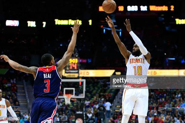 Tim Hardaway Jr #10 of the Atlanta Hawks shoots over Bradley Beal of the Washington Wizards during the first quarter in Game Three of the Eastern...