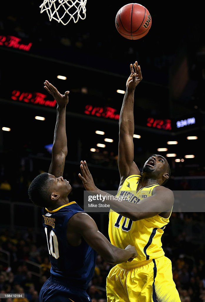 Tim Hardaway Jr. #10 of the Michigan Wolverines and Eron Harris #10 of the West Virginia Mountaineers battle for the ball during the Brooklyn Hoops Winter Festival on December 15, 2012 at Barclays Center in the Brooklyn borough of New York City. Michigan Wolverines defeated West Virginia Mountaineers 81-66.