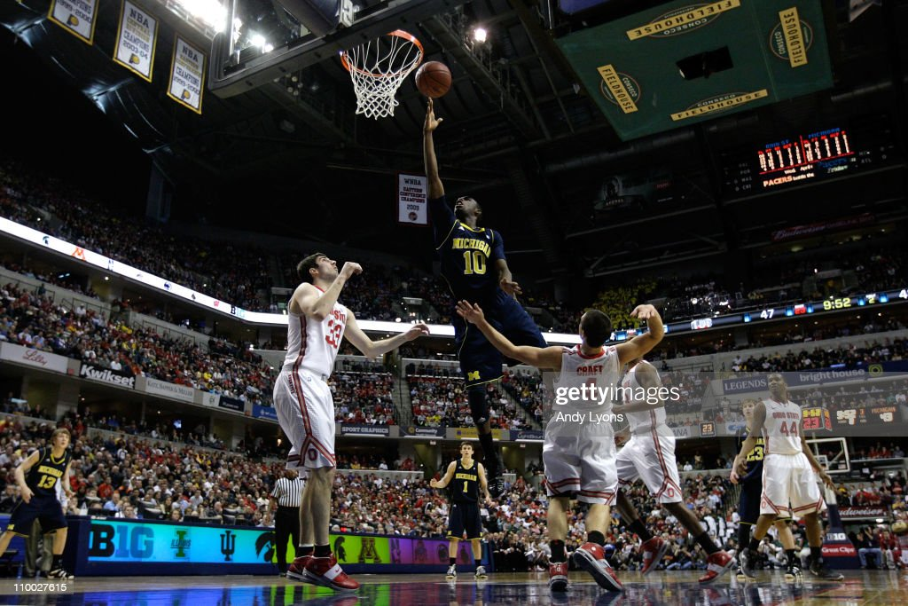 Tim Hardaway Jr #10 of the Michigan Wolverines attempts a shot against Jon Diebler and Aaron Craft of the Ohio State Buckeyes during the semifinals...