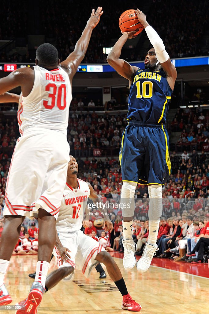 Tim Hardaway Jr. #10 of the Michigan Wolverines attempts a shot over Evan Ravenel #30 of the Ohio State Buckeyes in the first half on January 13, 2013 at Value City Arena in Columbus, Ohio. Ohio State defeated Michigan 56-53.