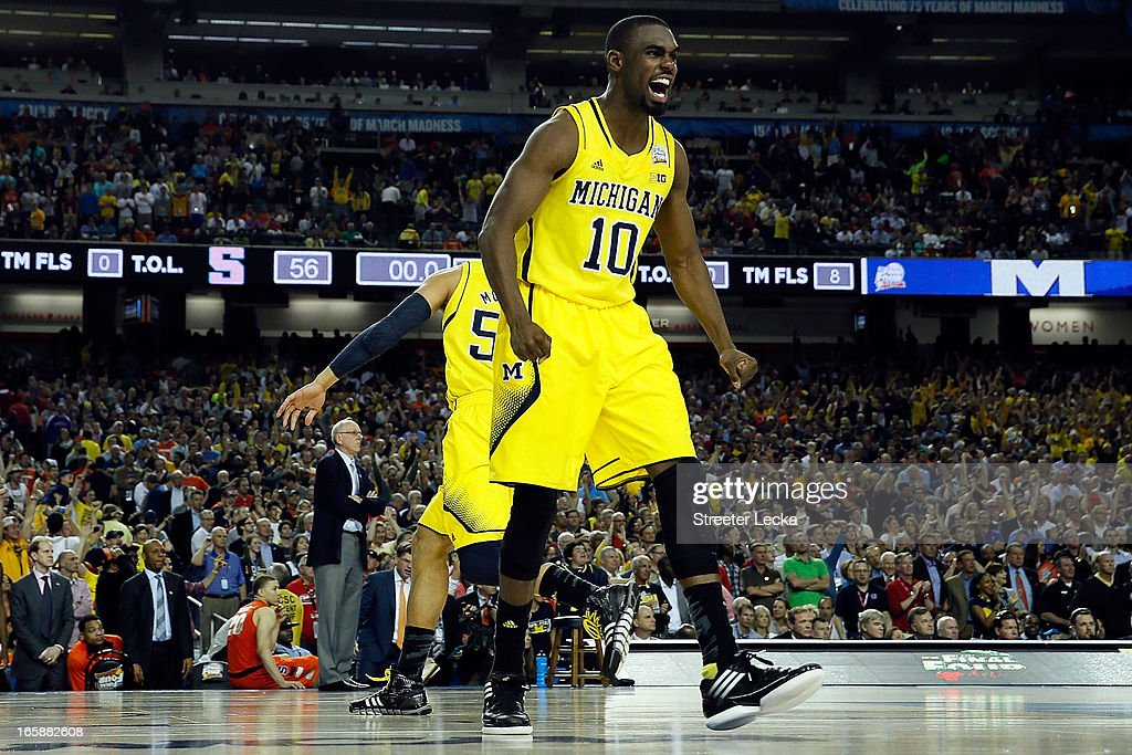Tim Hardaway Jr. #10 of the Michigan Wolverines celebrates after they won 61-56 against the Syracuse Orange during the 2013 NCAA Men's Final Four Semifinal at the Georgia Dome on April 6, 2013 in Atlanta, Georgia.