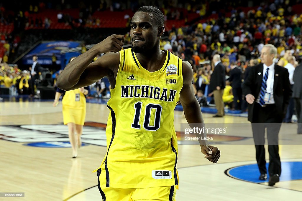 <a gi-track='captionPersonalityLinkClicked' href=/galleries/search?phrase=Tim+Hardaway+Jr.&family=editorial&specificpeople=7481128 ng-click='$event.stopPropagation()'>Tim Hardaway Jr.</a> #10 of the Michigan Wolverines celebrates the Wolverines 61-56 victory against the Syracuse Orange during the 2013 NCAA Men's Final Four Semifinal at the Georgia Dome on April 6, 2013 in Atlanta, Georgia.