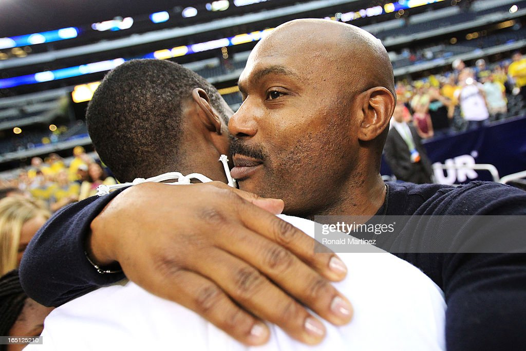 Tim Hardaway Jr. #10 of the Michigan Wolverines celebrates with his father Tim Hardaway after their 79 to 59 win over the Florida Gators during the South Regional Round Final of the 2013 NCAA Men's Basketball Tournament at Dallas Cowboys Stadium on March 31, 2013 in Arlington, Texas.