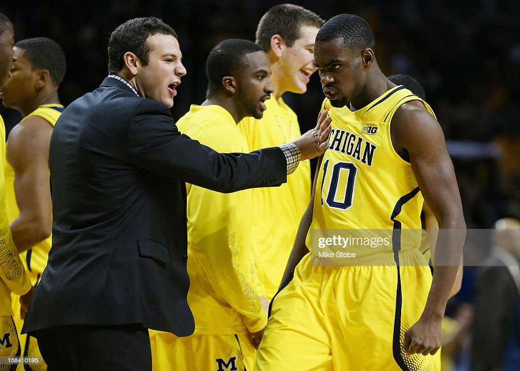 Tim Hardaway Jr. #10 of the Michigan Wolverines celebrates with Michigan Wolverines Video Analyst Peter Kahler after hitting a basket against West Virginia Mountaineers during the Brooklyn Hoops Winter Festival on December 15, 2012 at Barclays Center in the Brooklyn borough of New York City.
