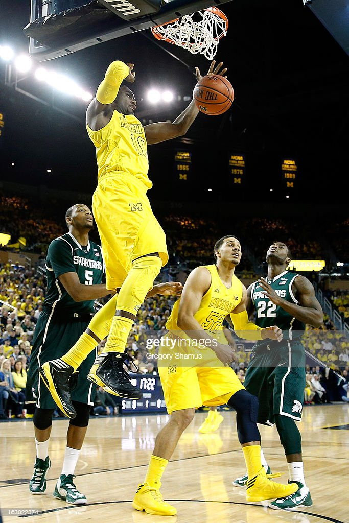 Tim Hardaway Jr. #10 of the Michigan Wolverines gets in for first half dunk while playing the Michigan State Spartans at Crisler Center on March 3, 2013 in Ann Arbor, Michigan.