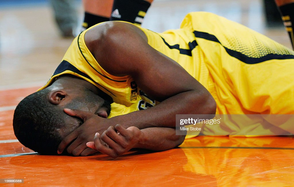 Tim Hardaway Jr. #10 of the Michigan Wolverines lies on the court after being injured in the second half during the game against the Kansas State Wildcats at Madison Square Garden on November 23, 2012 in New York City. Michigan Wolverines defeated Kansas State Wildcats 71-57.