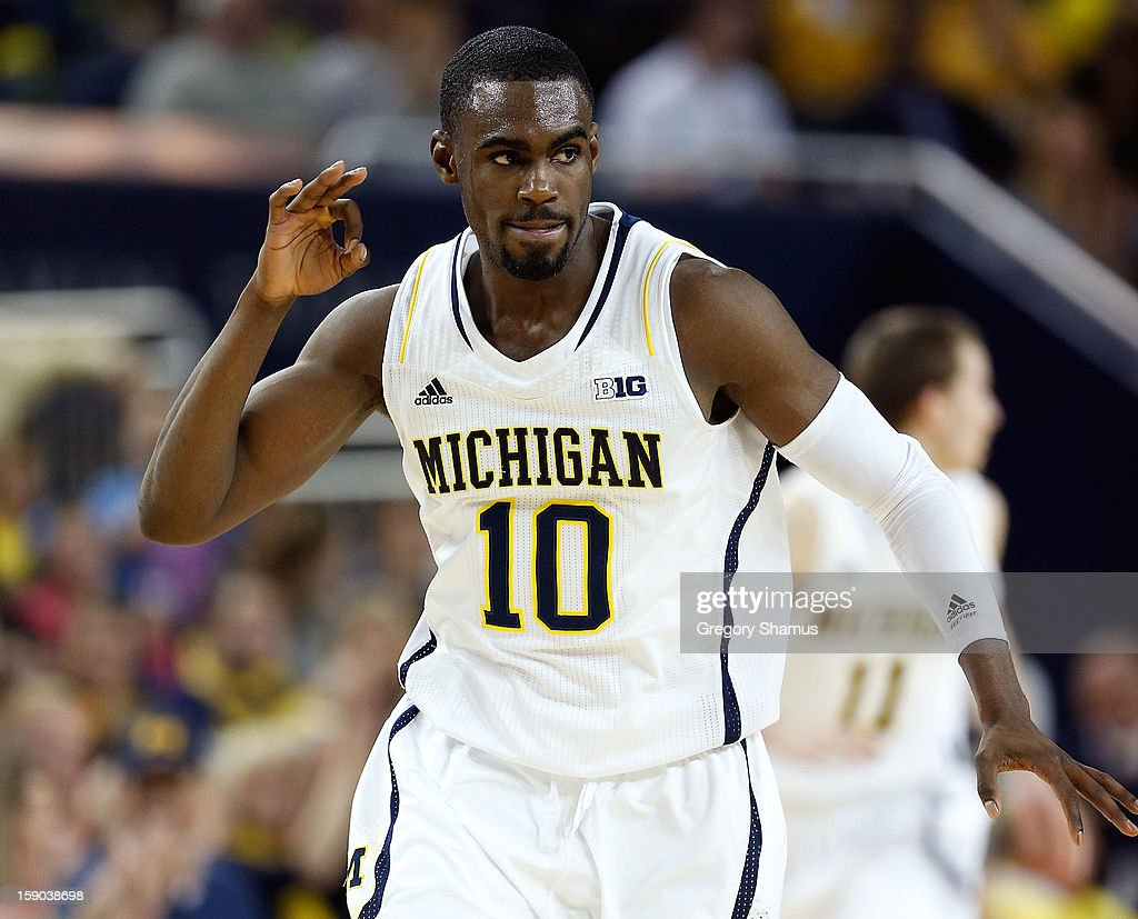 Tim Hardaway Jr. #10 of the Michigan Wolverines reacts after a second half three point basket while playing the Iowa Hawkeyes at Crisler Center on January 6, 2013 in Ann Arbor, Michigan. Michigan won the game 95-67.
